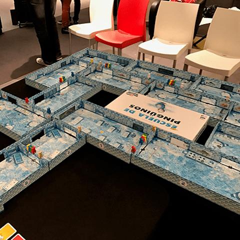 cajas juego de mesa Escuela de Pingüinos