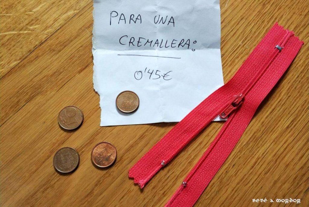 Experiencia de la cremallera roja y monedas