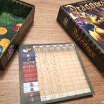 Libreta de puntuaciones y caja El Tesoro de los Dragones