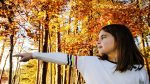 a-little-princess-has-spotted-a-faerie-in-the-enchanted-forest-full-of-orange-and-lights-in-the-fall_t20_e90467