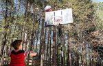 little-boy-generation-z-playing-basketball-outside-making-a-goal_t20_nLP024