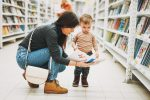 cute-baby-boy-toddler-child-in-bookstore-with-mother-with-open-book_t20_7yP60N