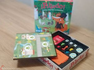componentes y caja del juego de mesa ¡Pillado!